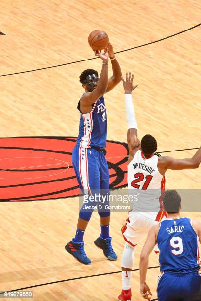Joel Embiid of the Philadelphia 76ers shoots the ball against the Miami Heat in Game Four of Round One of the 2018 NBA Playoffs on April 21 2018 at...
