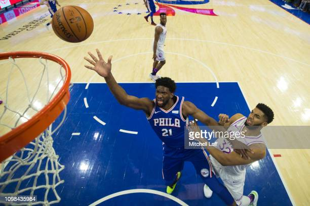 Joel Embiid of the Philadelphia 76ers shoots the ball against KarlAnthony Towns of the Minnesota Timberwolves at the Wells Fargo Center on January 15...