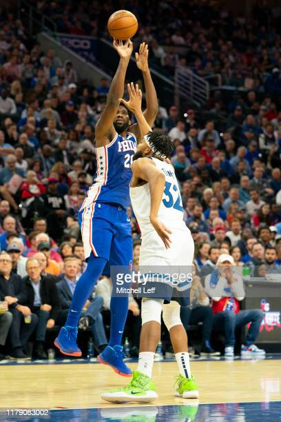 Joel Embiid of the Philadelphia 76ers shoots the ball against KarlAnthony Towns of the Minnesota Timberwolves in the second quarter at the Wells...