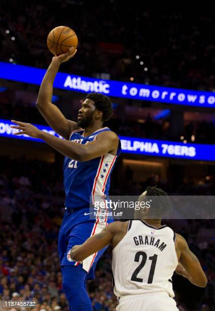 Joel Embiid of the Philadelphia 76ers shoots the ball against Treveon Graham of the Brooklyn Nets in the third quarter of Game Two of Round One of...