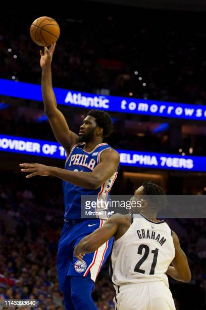 Joel Embiid of the Philadelphia 76ers shoots the ball against Treveon Graham of the Brooklyn Nets in Game Two of Round One of the 2019 NBA Playoffs...