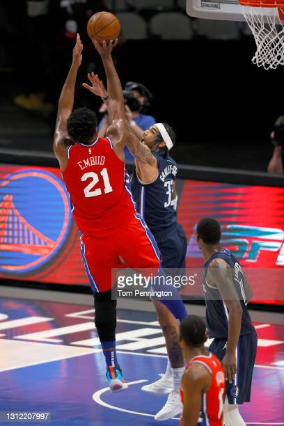 Joel Embiid of the Philadelphia 76ers shoots the ball against Willie Cauley-Stein of the Dallas Mavericks in the second quarter at American Airlines...