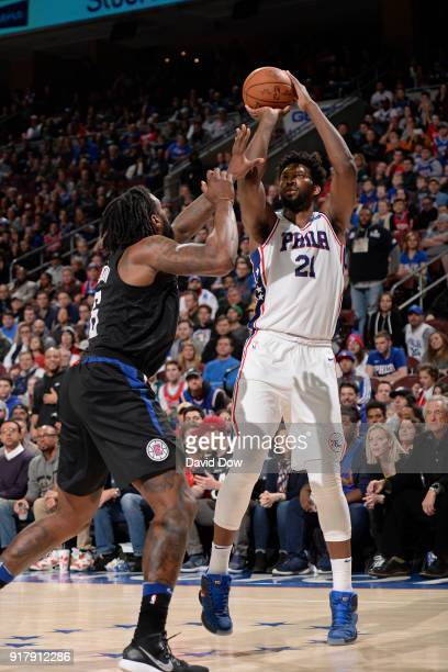 Joel Embiid of the Philadelphia 76ers shoots the ball while guarded by DeAndre Jordan of the LA Clippers at Wells Fargo Center on February 10 2018 in...