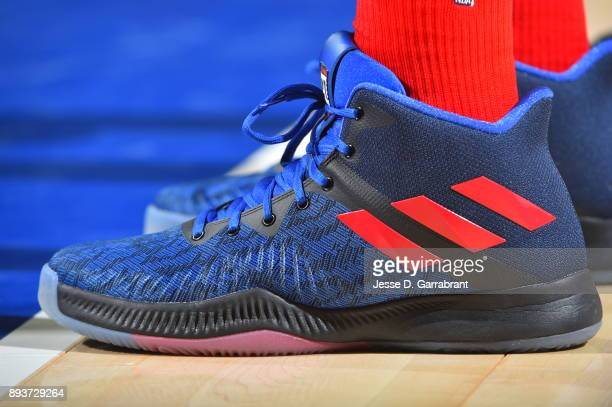 Joel Embiid of the Philadelphia 76ers showcases his sneakers against the Oklahoma City Thunder at Wells Fargo Center on December 15 2017 in...