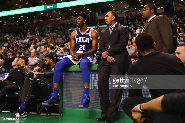 Joel Embiid of the Philadelphia 76ers sits on a video board during the fourth quarter against the Boston Celtics at TD Garden on January 18 2018 in...