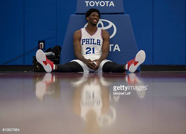 Joel Embiid of the Philadelphia 76ers sits on the court during media day on September 26 2016 in Camden New Jersey NOTE TO USER User expressly...