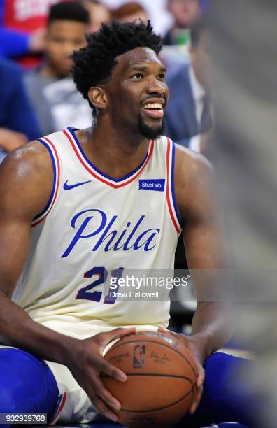 Joel Embiid of the Philadelphia 76ers smiles after getting fouled to the floor during the game against the Brooklyn Nets at the Wells Fargo Center on...