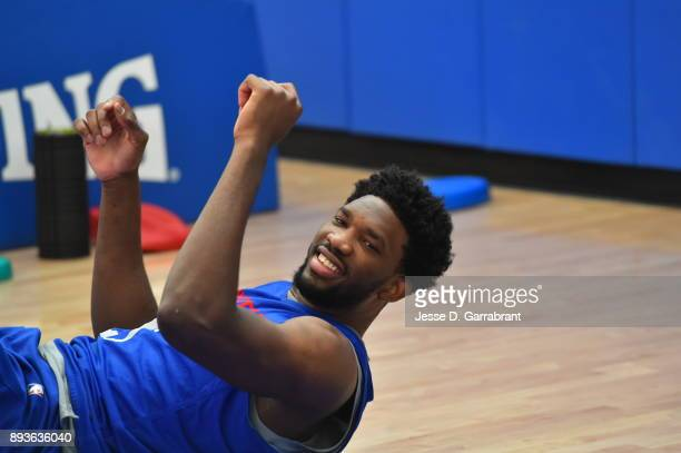 Joel Embiid of the Philadelphia 76ers stretches during practice at the Sixers Training Complex in Camden New Jersey on December 14 2017 NOTE TO USER...