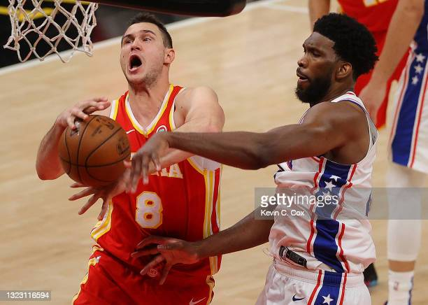 Joel Embiid of the Philadelphia 76ers strips the ball from Danilo Gallinari of the Atlanta Hawks during the second half of game 3 of the Eastern...