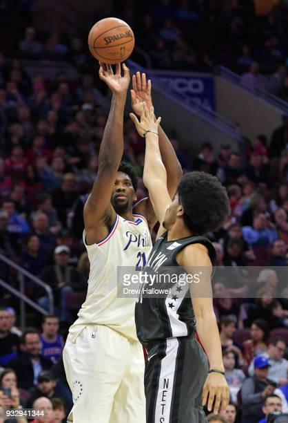 Joel Embiid of the Philadelphia 76ers takes a jump shot over Jarrett Allen of the Brooklyn Nets at the Wells Fargo Center on March 16 2018 in...