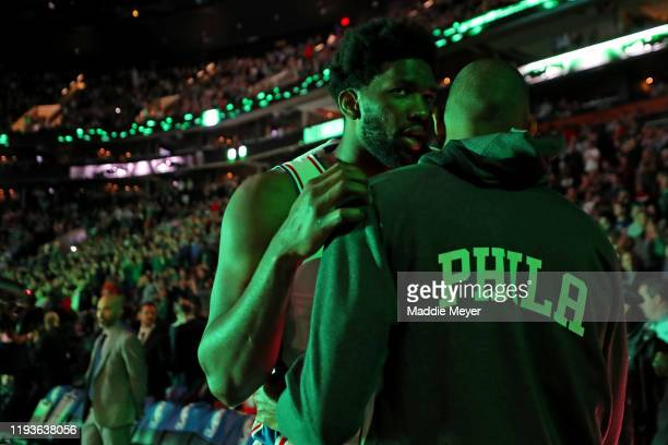 Joel Embiid of the Philadelphia 76ers talks with Al Horford before the game against the Boston Celtics at TD Garden on December 12 2019 in Boston...