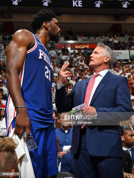 Joel Embiid of the Philadelphia 76ers talks with Brett Brown during the game against the Miami Heat in Game Three of Round One of the 2018 NBA...