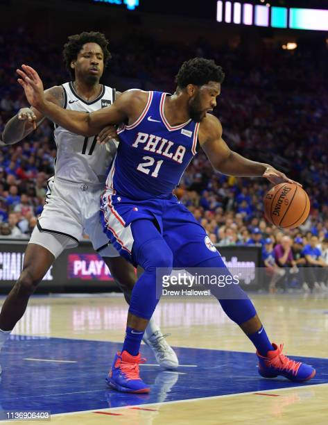 Joel Embiid of the Philadelphia 76ers tries to drive to the net on Ed Davis of the Brooklyn Nets in the second half during Game One of the first...