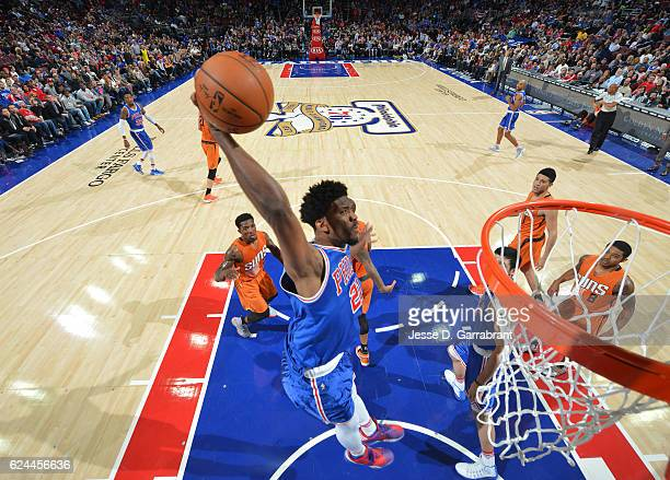Joel Embiid of the Philadelphia 76ers with the dunk against the Phoenix Suns during a game at the Wells Fargo Center on November 19 2016 in...