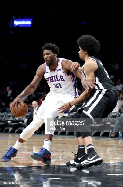 Joel Embiid of the Philadelphia 76ers works against Jarrett Allen of the Brooklyn Nets in the third quarter during their game at Barclays Center on...
