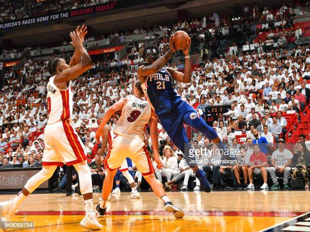 Joel Embiid of the Philadelphia 76ersp looks to pass the ball against the Miami Heat in Game Three of Round One of the 2018 NBA Playoffs on April 19...