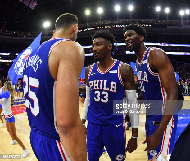 Joel Embiid Robert Covington and Ben Simmons of the Philadelphia 76ers talk after tonights win against the Atlanta Hawks at Wells Fargo Center on...