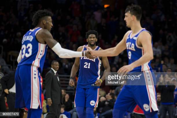 Joel Embiid Robert Covington and Dario Saric of the Philadelphia 76ers celebrate in the fourth quarter against the Toronto Raptors at the Wells Fargo...