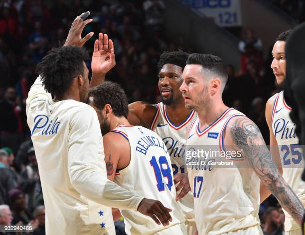 Joel Embiid Robert Covington JJ Redick and Ben Simmons of the Philadelphia 76ers give each other high fives against the Brooklyn Nets at the Wells...