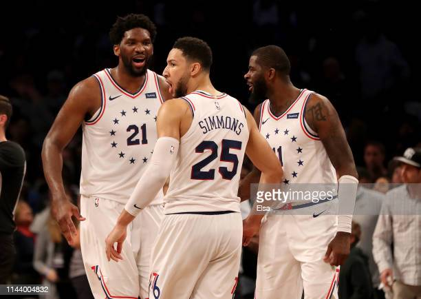 Joel Embiid,Ben Simmons and James Ennis III celebrate late in the fourth quarter against the Brooklyn Nets at Barclays Center on April 20, 2019 in...