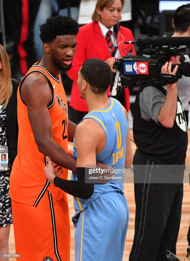 Joel Emiid #21 of the World Team greets Jayson Tatum #0 after the game. Mountain Dew Kickstart Rising Stars Game during All-Star Friday Night as part of 2018 NBA All-Star Weekend at the STAPLES Center on February 16, 2018 in Los Angeles, California.