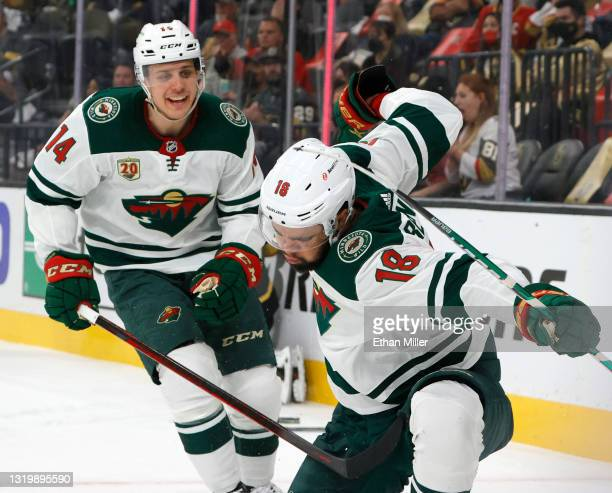Joel Eriksson Ek and Jordan Greenway of the Minnesota Wild celebrate Greenway's first-period goal against the Vegas Golden Knights in Game Five of...