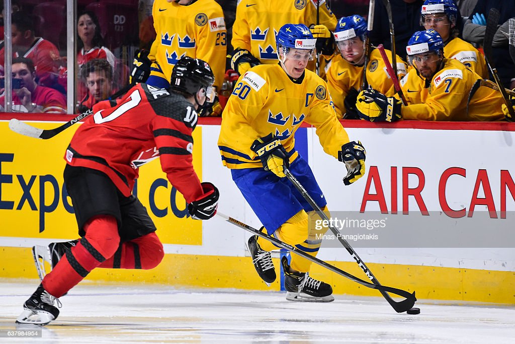 Joel Eriksson Ek #20 of Team Sweden skates the puck near Kale Clague #10 of Team Canada during the 2017 IIHF World Junior Championship semifinal game at the Bell Centre on January 4, 2017 in Montreal, Quebec, Canada. Team Canada defeated Team Sweden 5-2 and move on to the gold medal round.