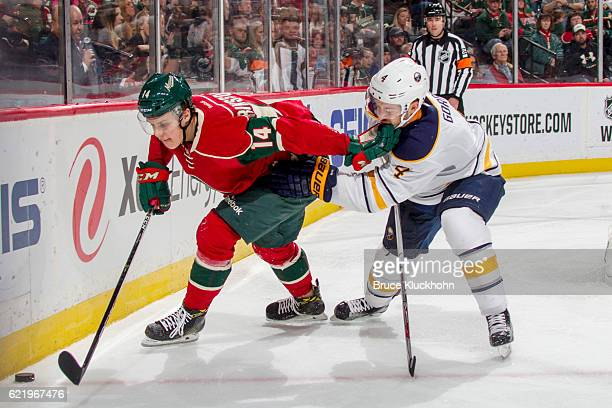 Joel Eriksson Ek of the Minnesota Wild and Josh Gorges of the Buffalo Sabres battle for the puck during the game on November 1 2016 at the Xcel...