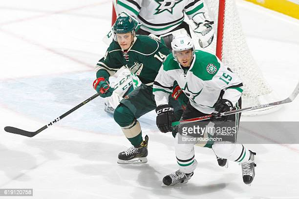 Joel Eriksson Ek of the Minnesota Wild and Patrik Nemeth of the Dallas Stars skate to the puck during the game on October 29 2016 at the Xcel Energy...