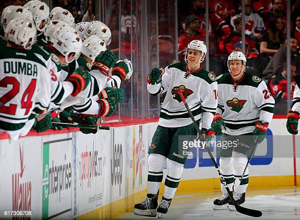 Joel Eriksson Ek of the Minnesota Wild celebrates his first NHL goal with teammates on the bench in the second period against New Jersey Devils on...