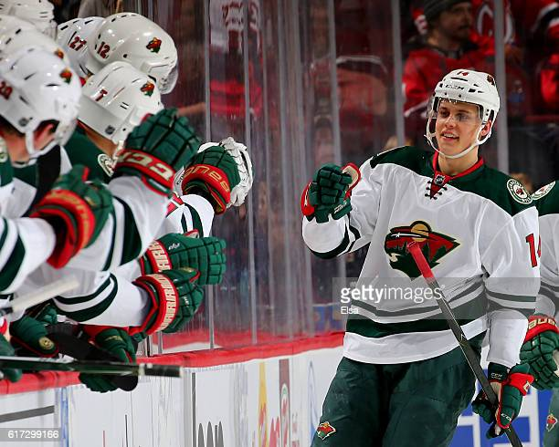 Joel Eriksson Ek of the Minnesota Wild celebrates his goal with teammates on the bench in the second period against New Jersey Devils on October 22...