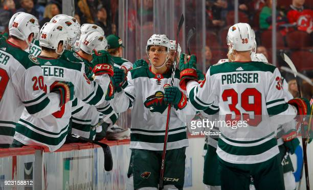 Joel Eriksson Ek of the Minnesota Wild celebrates his second period goal against the New Jersey Devils with his teammates on February 22 2018 at...