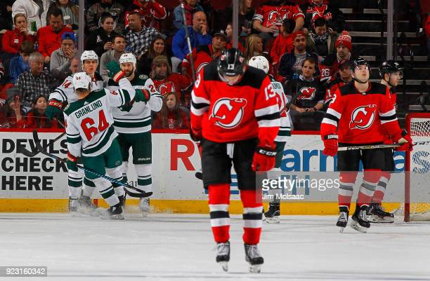 Joel Eriksson Ek of the Minnesota Wild celebrates his second period goal with teammates Daniel Winnik and Mikael Granlund of the Minnesota Wild as...