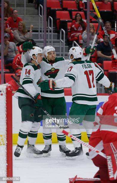 Joel Eriksson Ek of the Minnesota Wild celebrates his thirdperiod goal against the Detroit Red Wings with Chris Stewart and Marcus Foligno at Little...
