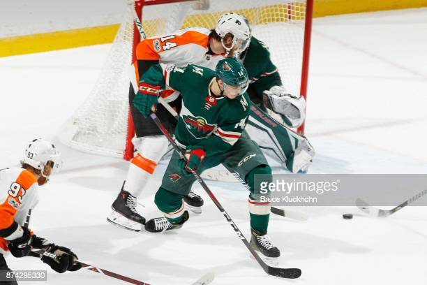 Joel Eriksson Ek of the Minnesota Wild defends Sean Couturier of the Philadelphia Flyers during the game at the Xcel Energy Center on November 14...