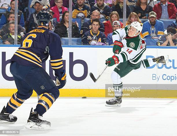 Joel Eriksson Ek of the Minnesota Wild fires a shot against Cody Franson of the Buffalo Sabres for a first period goal during an NHL game at the...