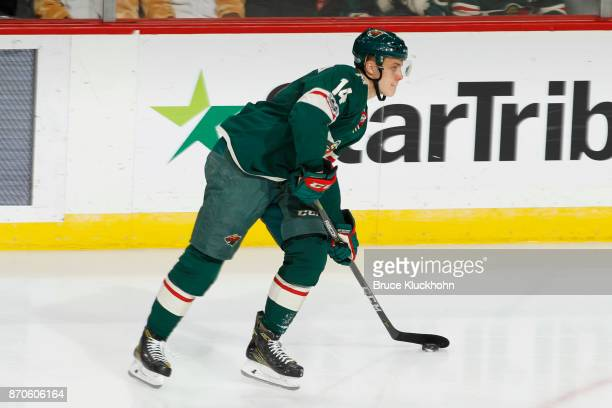 Joel Eriksson Ek of the Minnesota Wild handles the puck against the Winnipeg Jets during the game at the Xcel Energy Center on October 31 2017 in St...