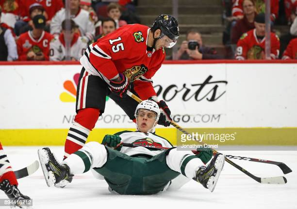 Joel Eriksson Ek of the Minnesota Wild hits the ice after battling with Artem Anisimov of the Chicago Blackhawks at the United Center on December 17...