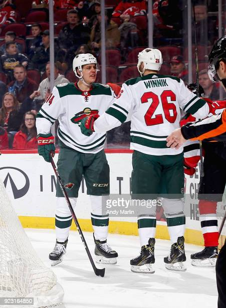 Joel Eriksson Ek of the Minnesota Wild is congratulated by Daniel Winnik after scoring a secondperiod goal against the New Jersey Devils during the...