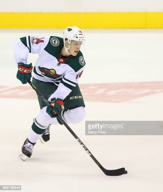 Joel Eriksson Ek of the Minnesota Wild plays the puck down the ice during first period action against the Winnipeg Jets at the Bell MTS Place on...