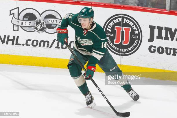 Joel Eriksson Ek of the Minnesota Wild skates with the puck against the Colorado Avalanche during the game on April 2 2017 at the Xcel Energy Center...