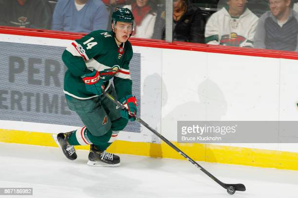 Joel Eriksson Ek of the Minnesota Wild skates with the puck against the Vancouver Canucks during the game at the Xcel Energy Center on October 24...