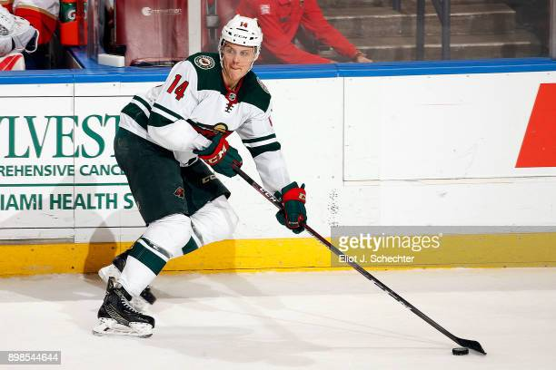 Joel Eriksson Ek of the Minnesota Wild skates with the puck against the Florida Panthers at the BBT Center on December 22 2017 in Sunrise Florida