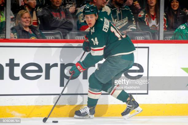 Joel Eriksson Ek of the Minnesota Wild skates with the puck against the San Jose Sharks during the game at the Xcel Energy Center on February 25 2018...