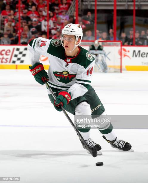 Joel Eriksson Ek of the Minnesota Wild skates with the puck during an NHL game against the Carolina Hurricanes on October 7 2017 at PNC Arena in...