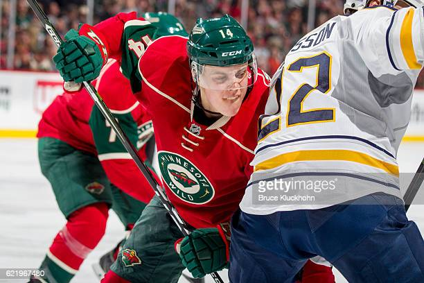 Joel Eriksson Ek of the Minnesota Wild takes a faceoff against Johan Larsson of the Buffalo Sabres during the game on November 1 2016 at the Xcel...