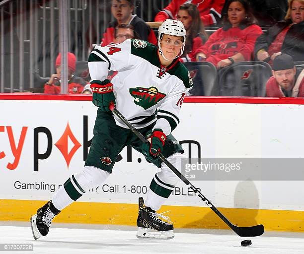 Joel Eriksson Ek of the Minnesota Wild takes the puck in the third period against New Jersey Devils on October 22 2016 at Prudential Center in Newark...