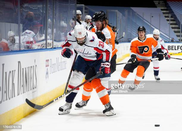 Joel Farabee of the Philadelphia Flyers and Radko Gudas of the Washington Capitals skate in the third period of a Round Robin game during the 2020...