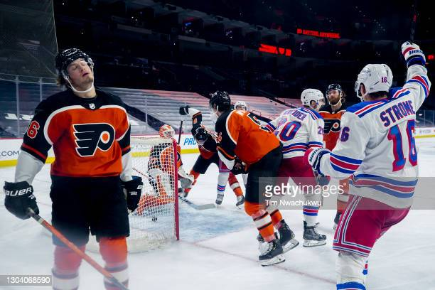 Joel Farabee of the Philadelphia Flyers and Ryan Strome of the New York Rangers react following a goal by Chris Kreider of the New York Rangers...