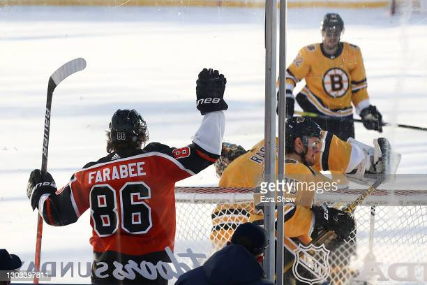 Joel Farabee of the Philadelphia Flyers celebrates after scoring a goal against the Boston Bruins in the first period during the 'NHL Outdoors At...